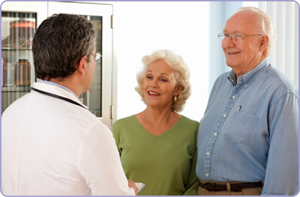 Pharmacist with elderly couple